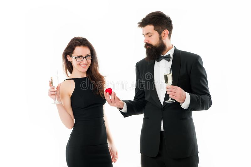Proposal of marriage. bearded man in tuxedo makes proposal to sexy woman. couple in love celebrate engagement with. Proposal of marriage. bearded men in tuxedo royalty free stock photography