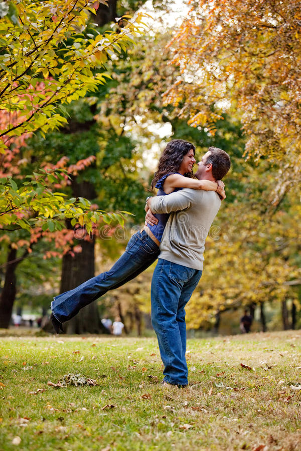 Propose. A man and woman hugging in a park royalty free stock photos