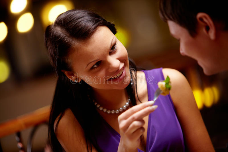 Propose food. Image of woman giving food her boyfriend royalty free stock images