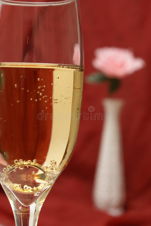 Proposing with Champagne. An engagement ring is set inside a glass of champagne to ask the big question royalty free stock photos