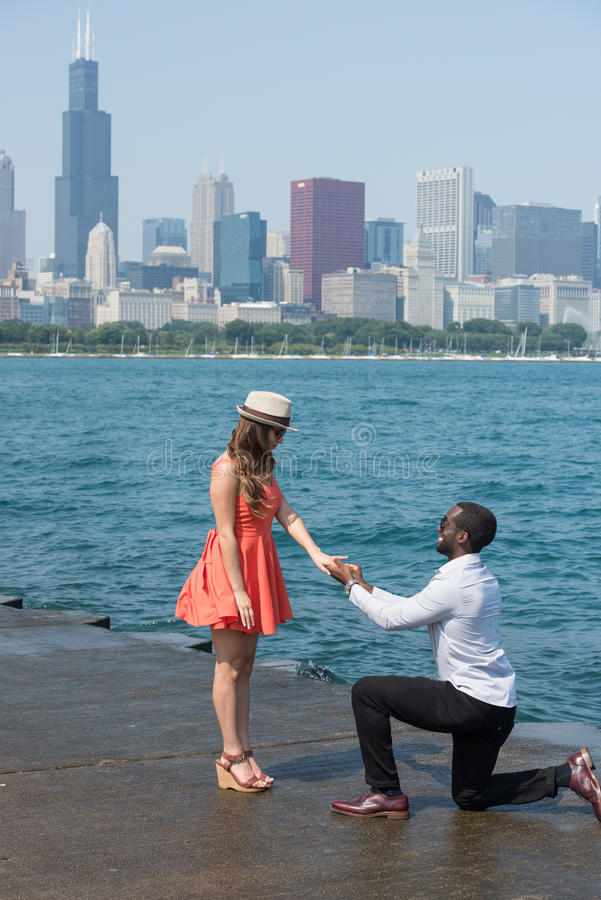 Proposing a girl. With a ring near a river royalty free stock photo