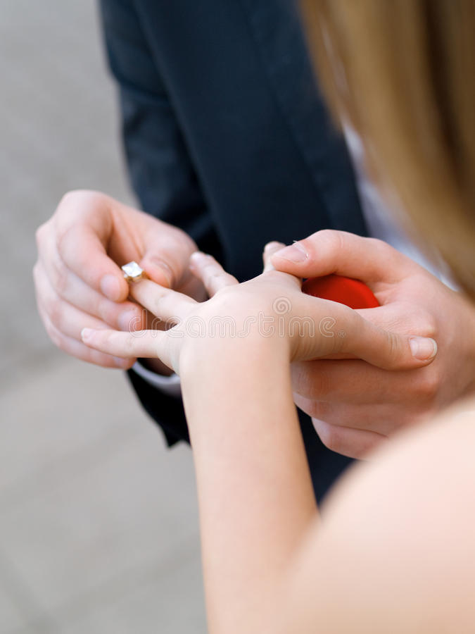 Proposing. A men proposing marriage to his girlfriend royalty free stock photography