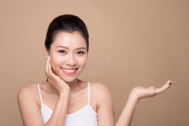 Proposing a product. Beautiful spa woman showing empty copy space on the open hand palm stock photos
