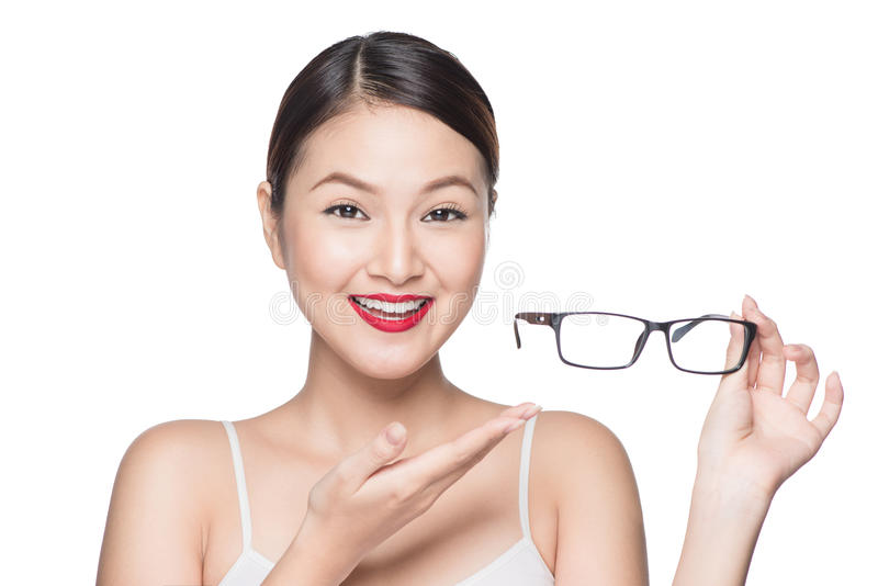 Proposing product. Beauty asian girl showing glasses.  royalty free stock photo