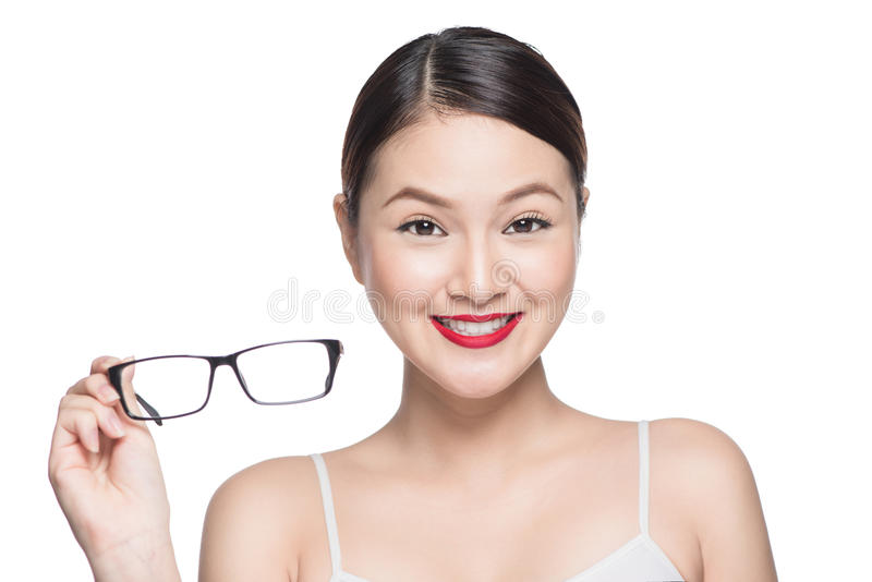 Proposing product. Beauty asian girl showing glasses.  stock images