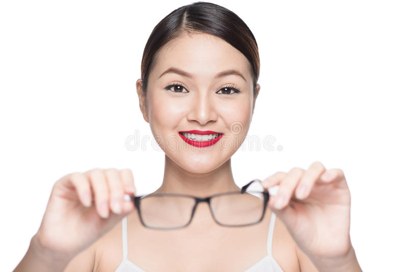Proposing product. Beauty asian girl showing glasses.  royalty free stock photos