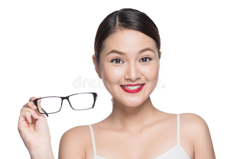 Proposing product. Beauty asian girl showing glasses.  royalty free stock images