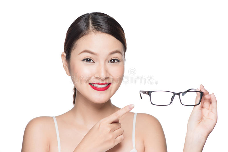 Proposing product. Beauty asian girl showing glasses.  stock photography