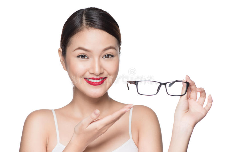 Proposing product. Beauty asian girl showing glasses.  stock image