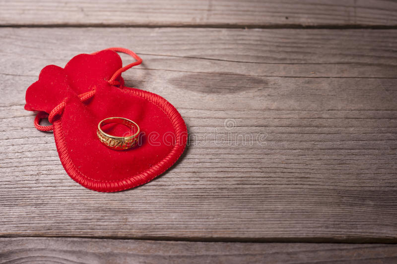 Proposing ring. Dating ring on a wooden table stock image