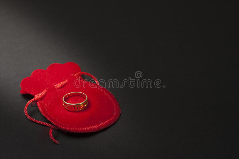 Proposing ring. Proposal ring on a wooden table royalty free stock photo