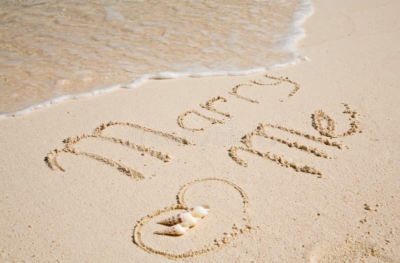 Proposition sur le sable photos stock