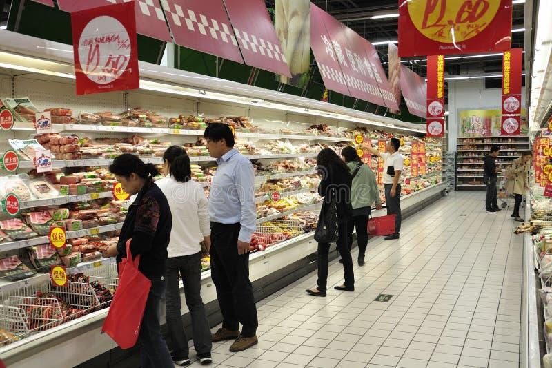Propriétaires de la Chine dans le supermarché photo stock