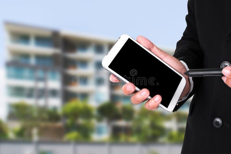 Proprietário do homem da empresa de bens imobiliários próspera imagem de stock royalty free