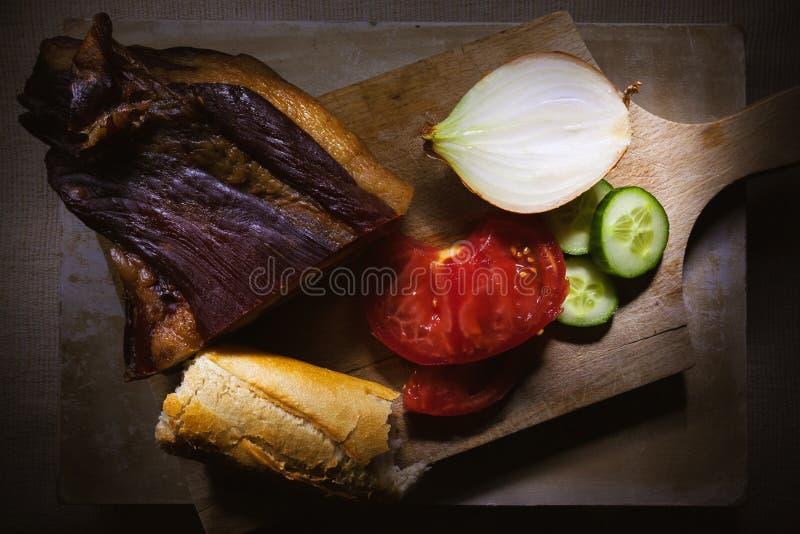 Prosciutto, chleb i warzywa, obrazy stock
