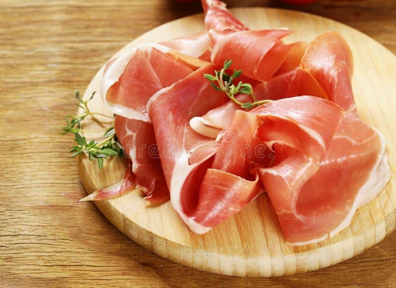 Prosciutto di Parma affumicato immagini stock
