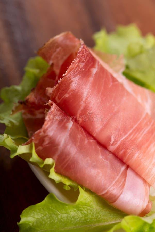 Prosciutto di Parma affumicato della macchietta immagine stock