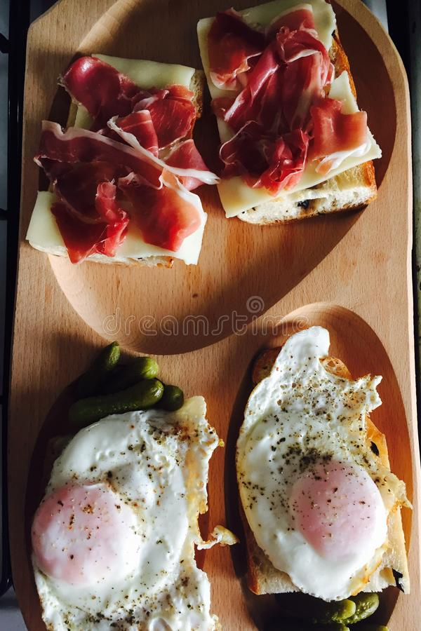 Prosciutto and eggs sandwiches royalty free stock image