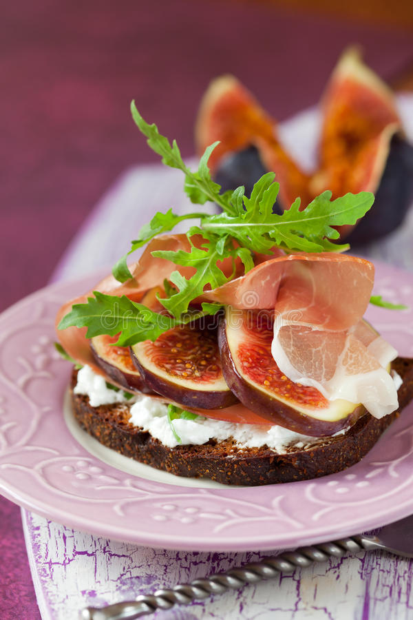 Prosciutto, fig, and cheese sandwich stock images