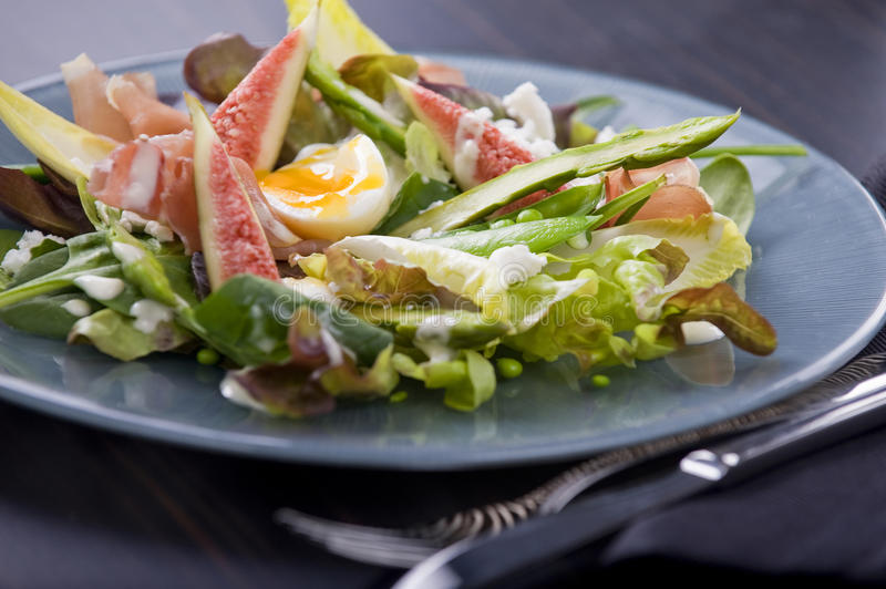 Prosciutto and fig salad with aioli royalty free stock photography