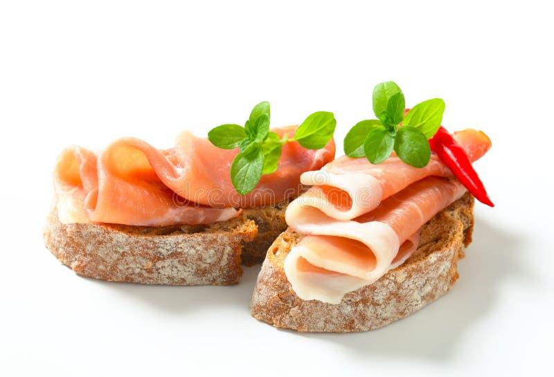 Prosciutto open faced sandwiches stock photography