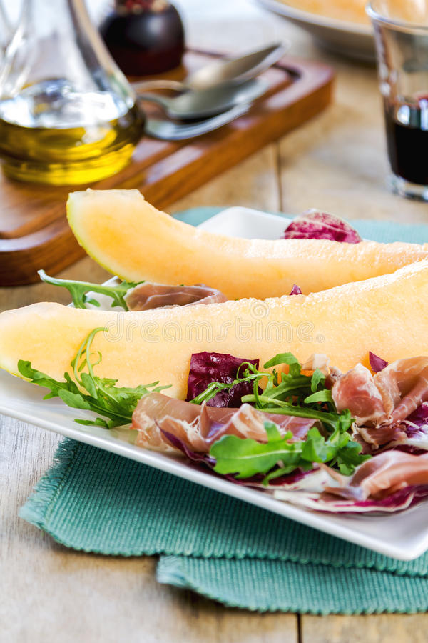 Prosciutto with rocket and cantaloupe salad. Prosciutto with rocket, cantaloupe and radicchio salad royalty free stock image
