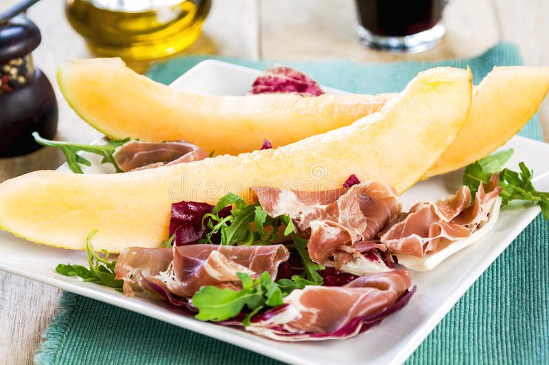 Prosciutto with rocket and cantaloupe salad. Prosciutto with rocket, cantaloupe and radicchio salad royalty free stock images