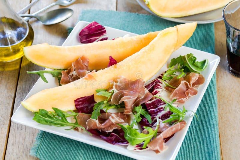Prosciutto with rocket and cantaloupe salad. Prosciutto with rocket, cantaloupe and radicchio salad stock photos
