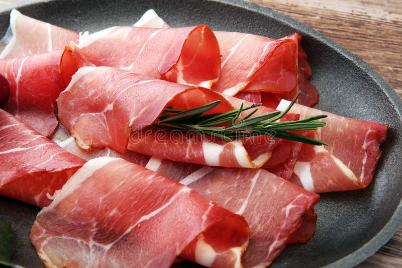 Prosciutto with rosemary or ham of black forest or serrano stock photo