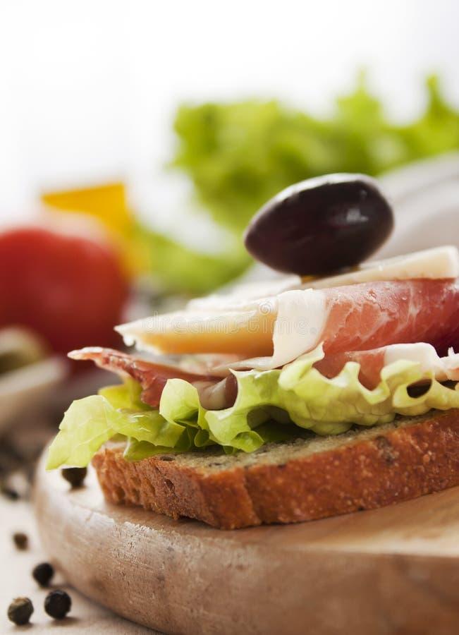 prosciutto serowa kanapka fotografia stock