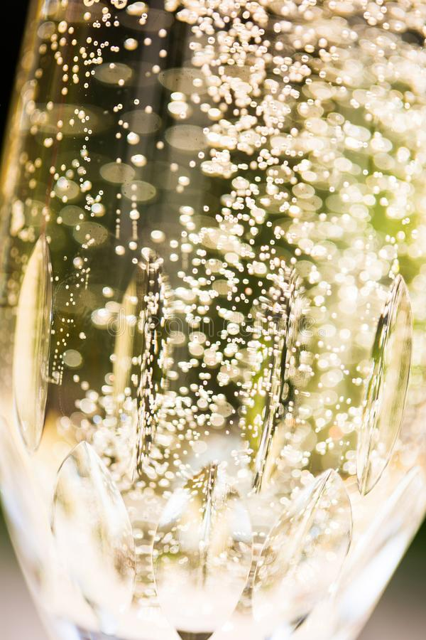 Prosecco with blubber, green background. Sparkle stock image