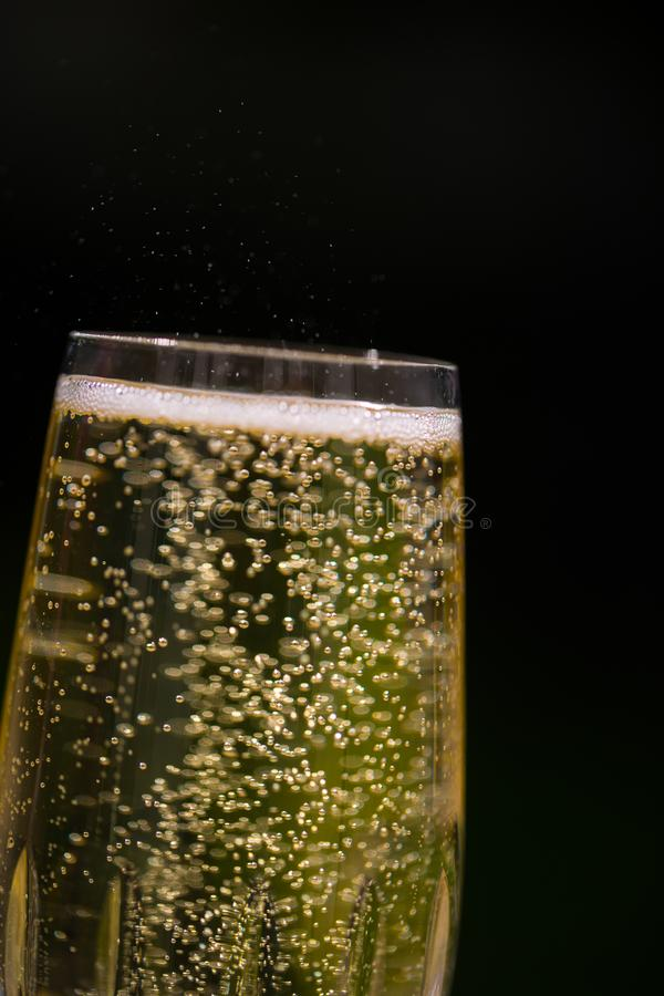 Prosecco with blubber, green background. Sparkle royalty free stock image