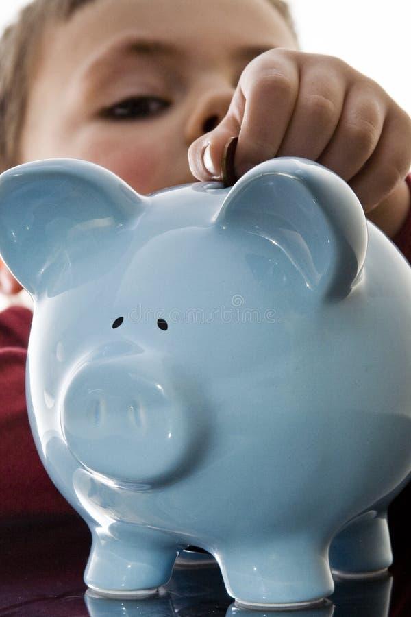 Prosiątka banka chłopiec obrazy royalty free