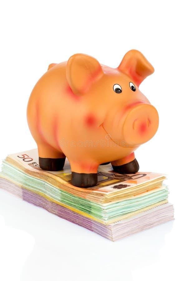 Prosiątko bank na banknotach obrazy stock