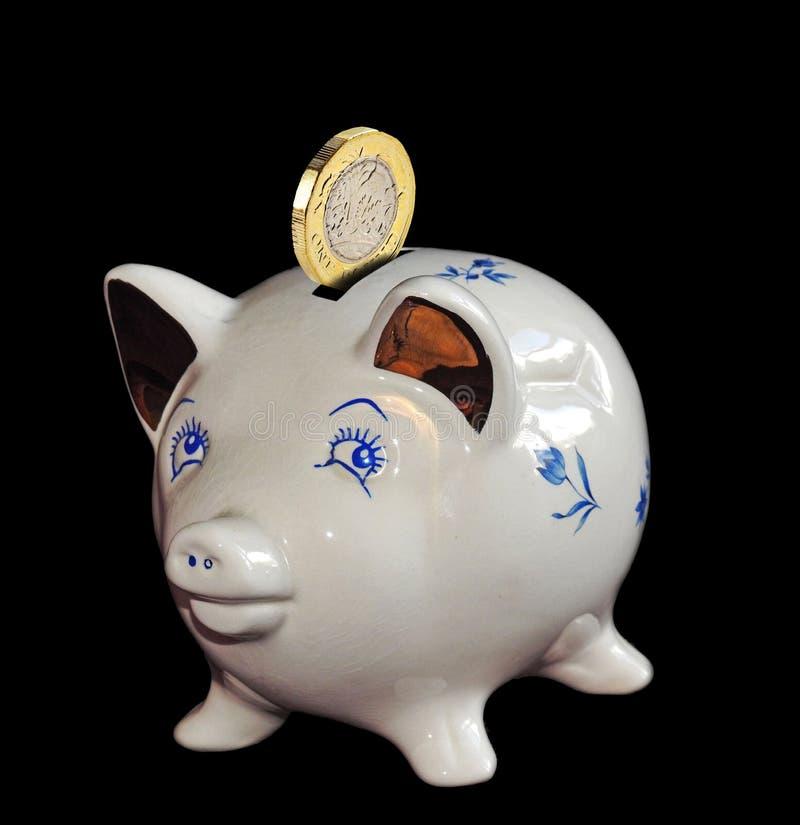 Prosiątko banka oszczędzań gotówki funtowej monety bankowość zdjęcie royalty free
