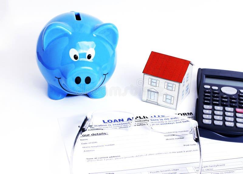 Prosiątko papieru i baku dom kalkulator i eyeglasses na Laon zdjęcie royalty free