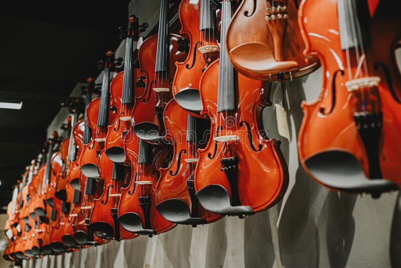 Prospect of a wooden brown violin in the window of a music store. The prospect of a wooden brown lacquered violin in the window of a music store.violinist stock photo