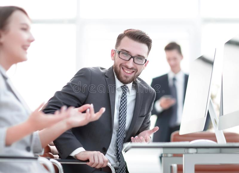 Prospective employees are talking at their Desk. Office life stock images