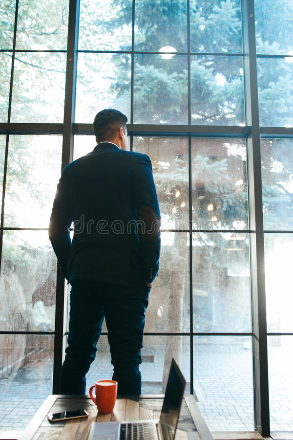Free Prosperous Businessman Standing Near Window Royalty Free Stock Photo - 77932895