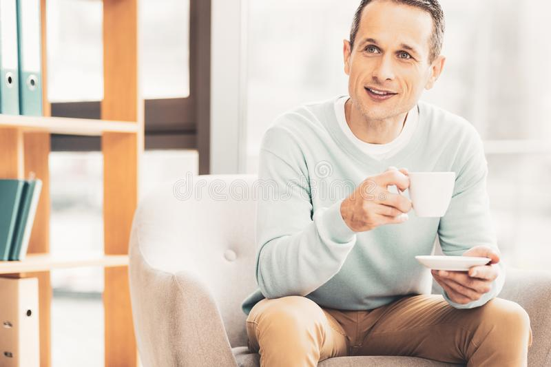Prosperous business man drinking tea during meeting stock photos