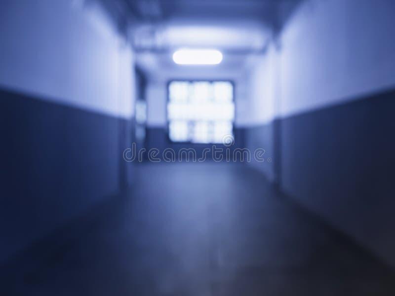 Prospettiva in costruzione vaga di corridoio vuoto fotografia stock
