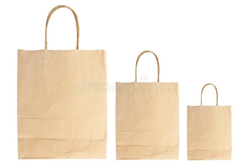 proste brown papierowe torby odizolowywać na bielu obraz royalty free