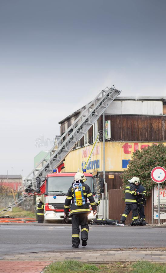 Prostejov Czech Rep 28th January - Firefighter ladder car next to a prefabricated house damaged by fire. Real situation firefigtin stock photography