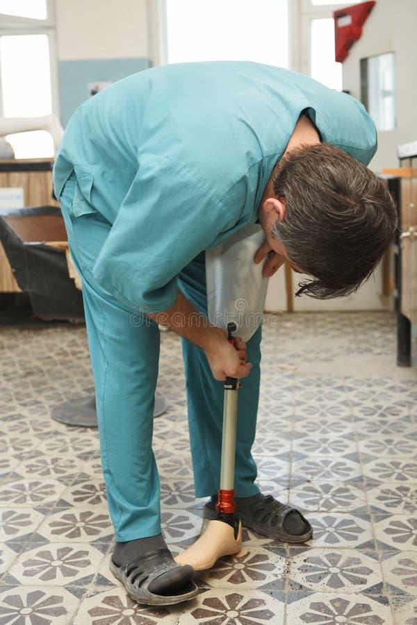 Prosthetist-orthopedist royalty free stock images