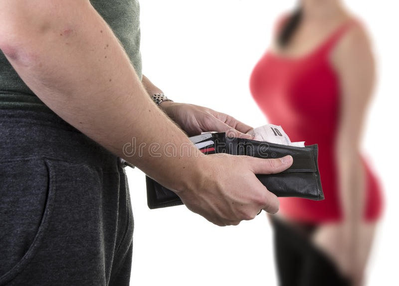 Prostitution. Man paying prostitute with banknotes from wallet royalty free stock photography