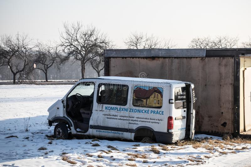 Damaged Renault Traffic white van abandoned near garages polluting the surroundings royalty free stock photography