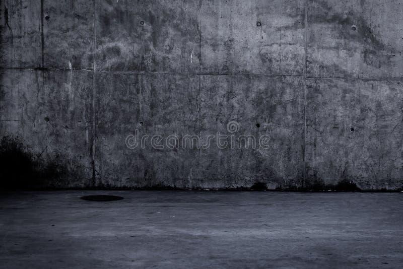 Prosty ciemny betonowej ściany tło z teksturą zdjęcia stock
