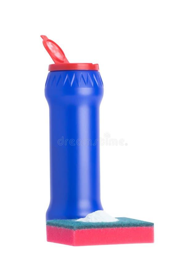 Proszek w błękitnej butelce i czerwieni gąbce odizolowywających na bielu zdjęcie royalty free