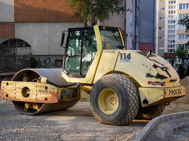Protec 114 Boxer road roller side view at street construction site. Miercurea Ciuc, Romania- 13 July 2019: Protec 114 Boxer road roller side view at street royalty free stock image