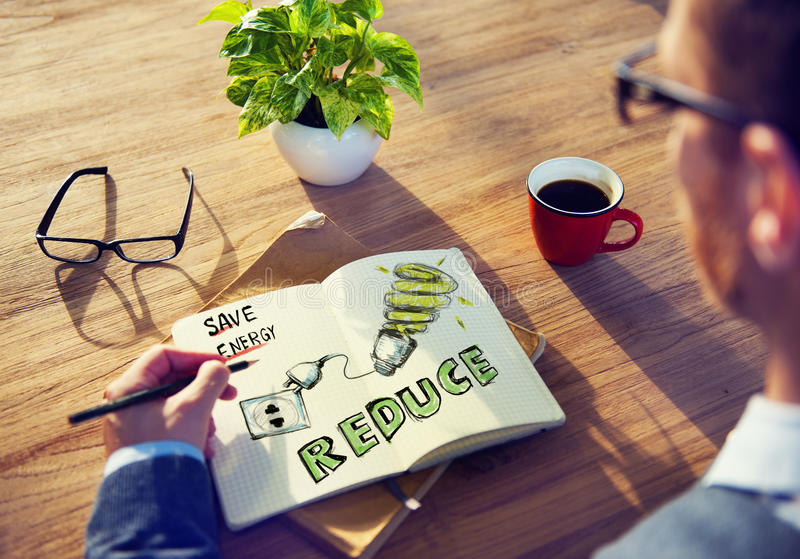 Protección de Brainstorming About Energy del hombre de negocios fotografía de archivo libre de regalías